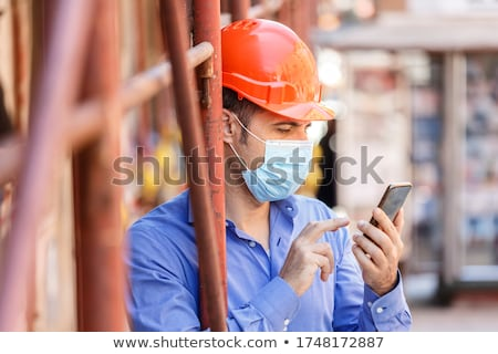 worker with a cellphone stock photo © photography33
