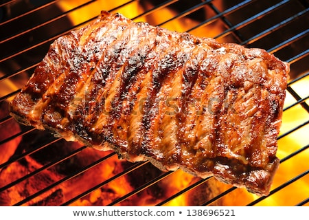 grilling ribs on barbecue stock photo © hofmeester