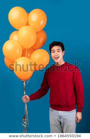 man holding a bunch of balloons is inviting to party Stock photo © feedough