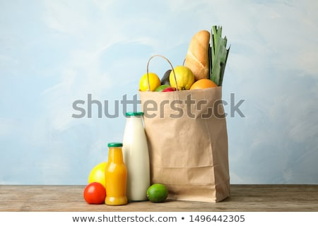 Paper Shopping Bag on blue background stock photo © heliburcka