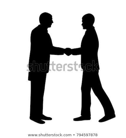 Kézfogás helyzet sziluettek férfi üzletember vállalati Stock fotó © Slobelix