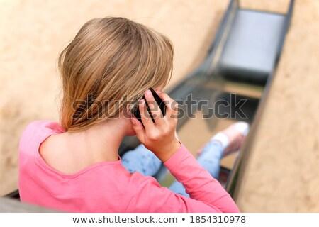 Jeunes écolière sms mobiles uniforme scolaire Photo stock © stryjek