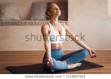 blond woman yoga exercise stock photo © w20er