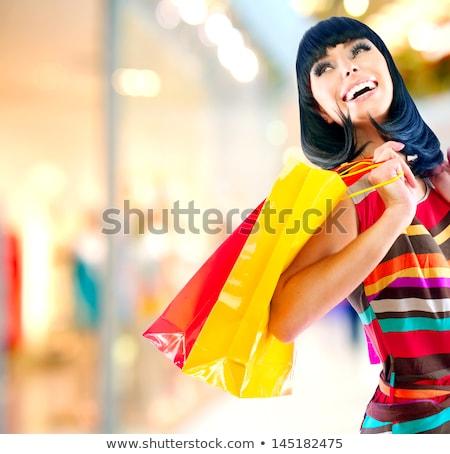 nő · ül · bevásárlótáskák · nappali · kanapé · vásár - stock fotó © hasloo