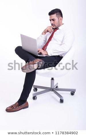 Indian young handsome man in thinking posture Stock photo © ziprashantzi
