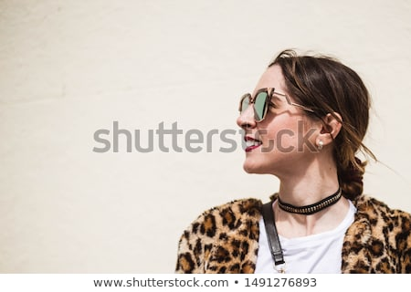 fashion woman in animal print coat posing stock photo © feedough