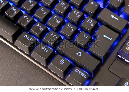 Closeup of backlit computer laptop keyboard selective focus on e Stock photo © keneaster1