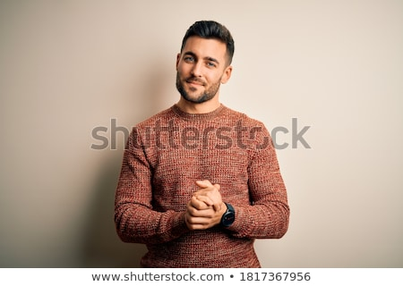 Handsome man relaxing on studio background Stock photo © feedough