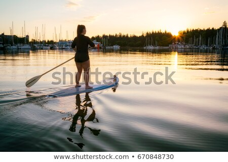 stand up paddling at springtime Stock photo © PixelsAway