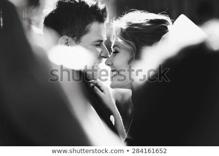 романтические момент целоваться кровать женщину Сток-фото © barabasa