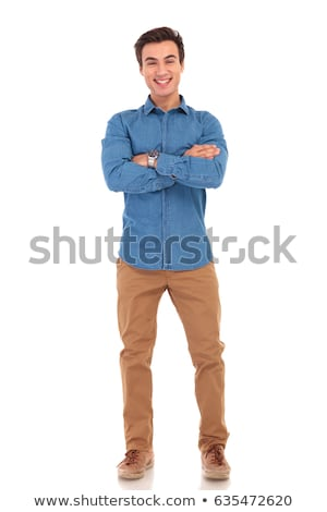 Full body picture of a casual young man posing Stock photo © feedough