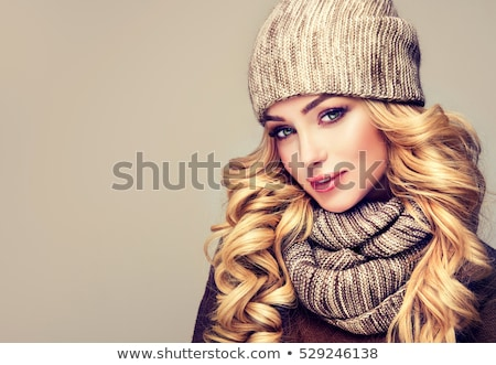 Blonde in winter clothes with hand out Stock photo © wavebreak_media