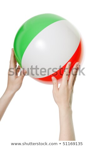 bright inflatable ball in hand isolated on white stock photo © tetkoren