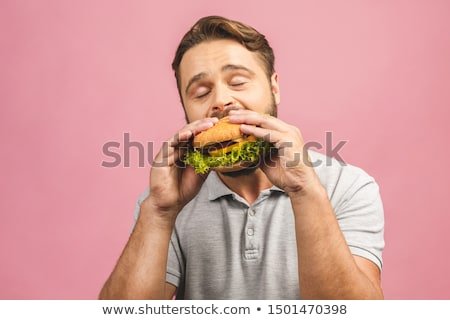 Stockfoto: Man · eten · hamburger · gelukkig · kaukasisch