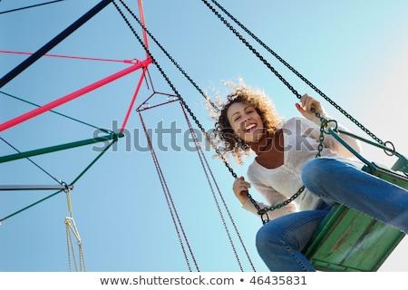 Charmant meisje drive rotonde naar camera Stockfoto © Paha_L