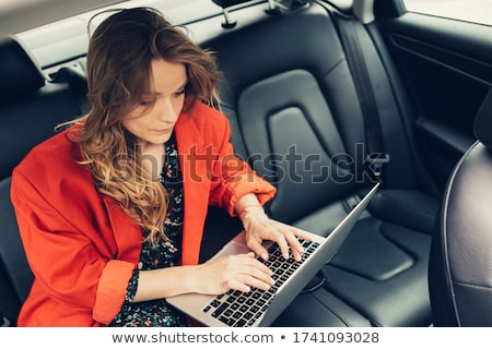 interior view of woman on phone in limousine stock photo © dash