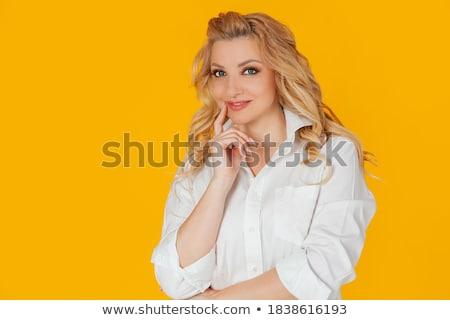 Güzel genç iş kadını ayakta dokunmak Stok fotoğraf © deandrobot