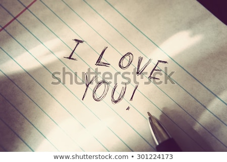 I love you written on a heart-shaped sign Stock photo © Zerbor