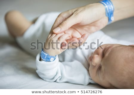 Newborn baby in hospital with id ribbon on his hand Stock photo © zurijeta