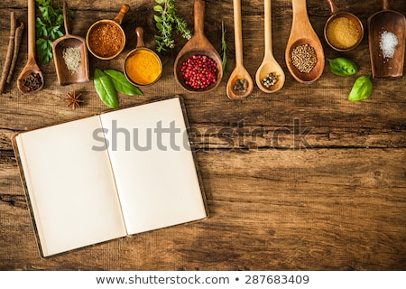 Foto d'archivio: Culinary Background And Recipe Book With Various Spices On Wooden Table