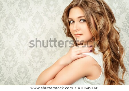 Wedding portrait of charming bride with long wavy hair and makeu Stock photo © Victoria_Andreas