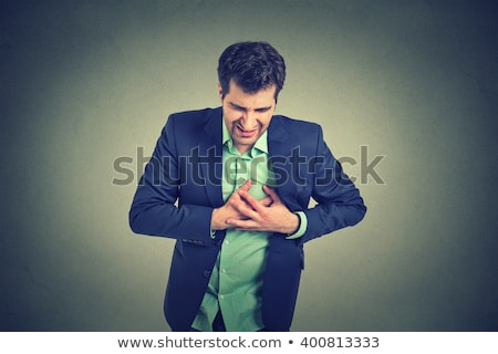 Adult man suffering from severe sharp heartache, chest pain Stock photo © ichiosea