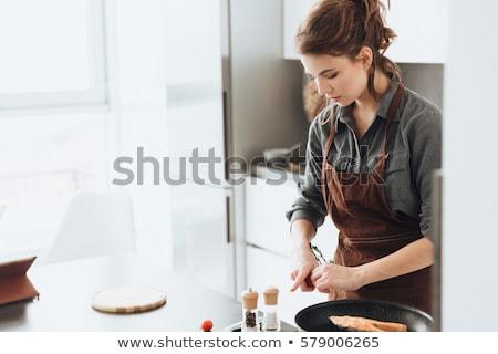 nő · áll · konyha · főzés · hal · fotó - stock fotó © deandrobot