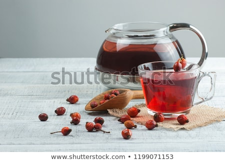 Dog rose or rosehip berries with leaves, dried briar Stock photo © yelenayemchuk