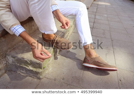 Shoes And Feet Of Man Sitting On Steps stock photo © dtiberio