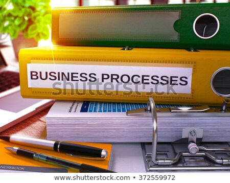 business processes on yellow office folder toned image stock photo © tashatuvango