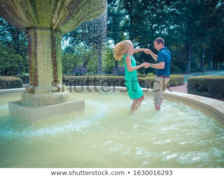 beautiful young couple at the fountain Stock photo © tekso