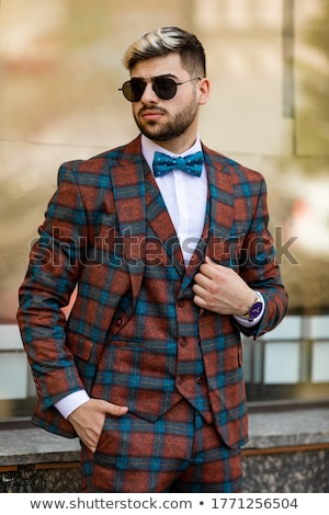 stylish trendy businessman in a business suit and sunglasses on stock photo © traimak