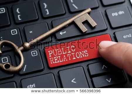 public relations   concept on red keyboard button stock photo © tashatuvango