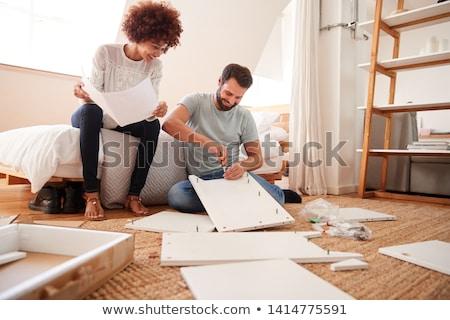 mulher · jovem · martelo · mãos · olhando · câmera · sorridente - foto stock © is2