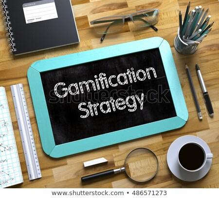 Game Developing - Text on Small Chalkboard. 3d Stock photo © tashatuvango
