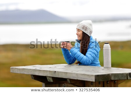 Woman enjoying hot drink from flask Stock photo © IS2