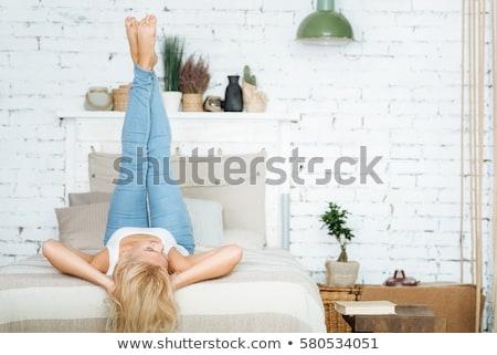 Bella donna bionda rilassante home sorridere Foto d'archivio © NeonShot
