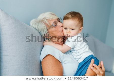 Two women kissing baby Stock photo © IS2