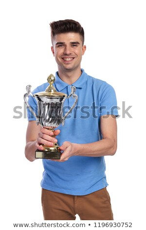 happy young casual man offering a trophy cup Stock photo © feedough