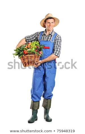 Portrait of a cheerful young man in straw hat standing stock photo © deandrobot