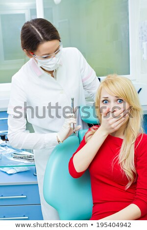 Scared Girl Covering Her Mouth With Hands In Clinic Stock photo © AndreyPopov
