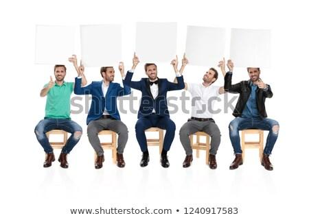 boldog · üzletember · bemutat · tábla · szürke · néz - stock fotó © feedough