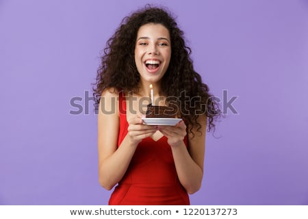 Image of seductive woman 20s wearing red dress smiling, standing Stock photo © deandrobot