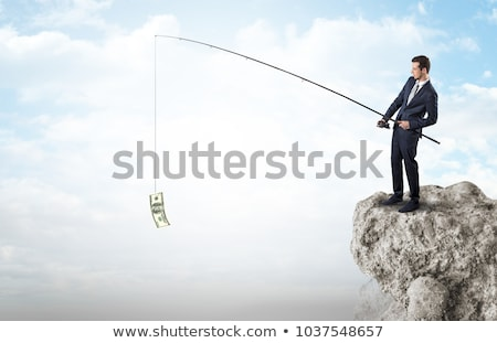 businessman fishing dollar from a rock stock photo © ra2studio