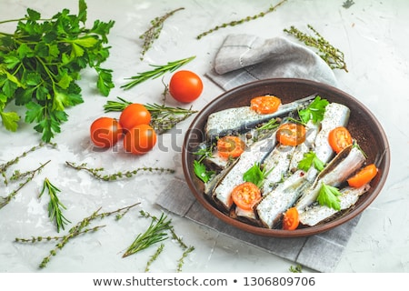 Stock photo: Sardines or baltic herring with rosemary, thyme, parsley,  tomat