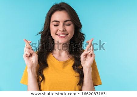 Mulher jovem posando isolado azul parede Foto stock © deandrobot