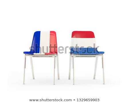 Two chairs with flags of France and netherlands Stock photo © MikhailMishchenko