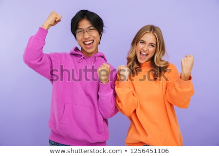 cheerful multhiethnic teenage couple standing together stock photo © deandrobot