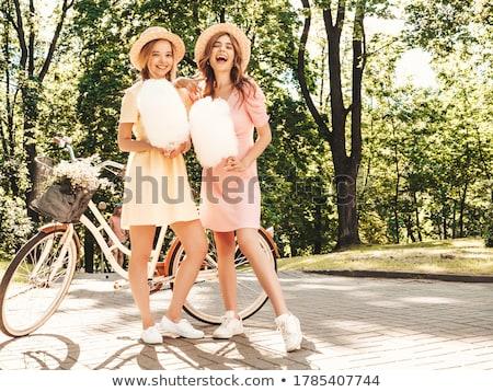 Divatos gyönyörű fiatal barátnők pamut cukorka Stock fotó © dashapetrenko
