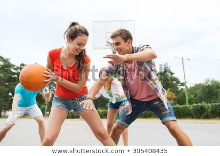 Active boys, girls and friends playing sport activities outdoors Stock photo © bluering